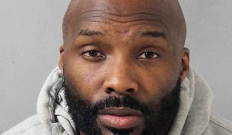This booking mug provided by the Metro Nashville Police Department shows Derrick Mason. Mason, a wide receiver who played 15 seasons in the NFL, has been charged with felony aggravated domestic assault and misdemeanor vandalism. Metro Nashville Police said in a release that Mason, 43, turned himself in Monday night, Oct. 30, 2017. (AP Photo/Metro Nashville Police Department via AP)
