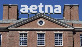 FILE - This Aug. 19, 2014, file photo, shows the corporate sign atop Aetna headquarters in Hartford, Conn. Aetna Inc. reports earnings Tuesday, Oct. 31, 2017. (AP Photo/Jessica Hill, File)