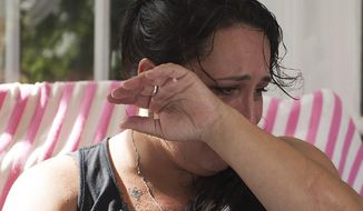 """This photo taken Sept. 26, 2017, shows Bonnie Smith wiping  tears from her face during an interview with the Courier-Post, at her home in Waterford Works, N.J. Smith lost her 21-year-old daughter, Emily, to opioids. """"I want kids to know what they're sentencing their parents to and their family to by taking drugs and doing heroin,"""" Smith said. """"It's horrible. It's hell."""" (Jose F. Moreno/Camden Courier-Post via AP)"""