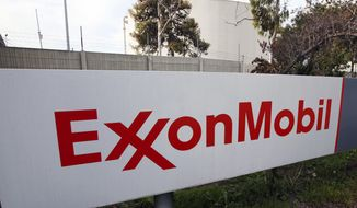 FILE - This Jan. 30, 2012, file photo, shows a sign at an Exxon Mobil refinery in California. Exxon Mobil is settling air pollution cases with the Trump administration by paying a $2.5 million civil penalty and promising to spend $300 million on pollution-control technology at several plants along the Gulf Coast. Federal officials said Tuesday, Oct. 31, 2017, that the settlement will prevent thousands of tons of future pollution, including cancer-causing benzene, from eight petrochemical plants in Texas and Louisiana. (AP Photo/Reed Saxon, File)