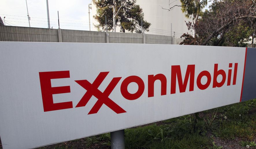 This Jan. 30, 2012, file photo, shows a sign at an Exxon Mobil refinery in California. On Jan. 5, 2018, the company announced its discovery of a major oil reservoir offshore of Guyana. (AP Photo/Reed Saxon, File)