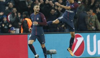 PSG's Layvin Kurzawa, celebrates after scoring his side's forth goal with his teammates PSG's Marquinhos during a Champions League Group B soccer match between Paris Saint-Germain and Anderlecht at Parc des Princes stadium in Paris, France, Tuesday, Oct. 31, 2017. (AP Photo/Thibault Camus)