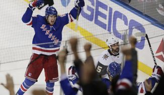 New York Rangers' Pavel Buchnevich (89) celebrates after scoring a goal as Vegas Golden Knights' Deryk Engelland (5) reacts during the third period of an NHL hockey game Tuesday, Oct. 31, 2017, in New York. The Rangers won 6-4. (AP Photo/Frank Franklin II)