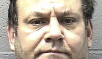 This undated photo provided by the Elgin Police Department in Elgin Ill., shows, Brian Peck. Elgin police said Tuesday, Oct. 31, 2017 that murder charges have been filed against Peck whose mother's dismembered remains are believed to have been found in a Chicago park lagoon. Peck, of Elgin faces two counts of first-degree murder and one count of concealment of a homicidal death. (Elgin Police Department via AP)