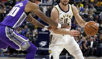 Indiana Pacers center Domantas Sabonis (11) drives around Sacramento Kings center Willie Cauley-Stein (00) during the second half of an NBA basketball game in Indianapolis, Tuesday, Oct. 31, 2017. The Pacers defeated the Kings 101-83. (AP Photo/Michael Conroy)