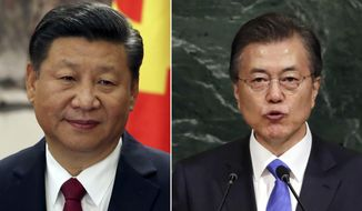 This combination of the file photos show Chinese President Xi Jinping, left, on Oct 25, 2017 in Beijing and  South Korean President Moon Jae-in on Sept. 21, 2017, at U.N. headquarters. South Korean senior presidential official told a televised briefing Tuesday, Oct. 31, 2017, that President Moon and Xi will talk on the sidelines of an annual regional forum in Vietnam next week. (AP Photo/Ng Han Guan, Richard Drew, File)