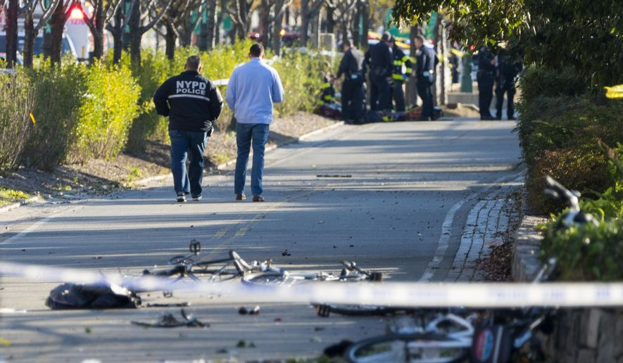 Bicycles and debris lay on a bike path near West and Houston Streets after people were injured after during incident on a bike path in New York Tuesday, Oct. 31, 2017. (AP Photo/Craig Ruttle)