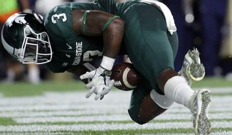 FILE - In this Sept. 23, 2017, file photo, Michigan State's LJ Scott tries unsuccessfully to recover his fumble in the end zone during the second quarter against Notre Dame in an NCAA college football game in East Lansing, Mich. The fumbling problems that plagued the Spartans early this season haven't really gone away, and they finally lost a Big Ten game last weekend at Northwestern. (AP Photo/Al Goldis, File)