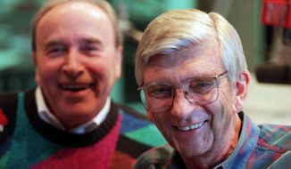 In this Jan. 7, 1998 photo, Roger Erickson, right, a longtime Minneapolis radio personality at WCCO Radio, poses with his partner Charlie Boone. Erickson's daughter, Tracy Anderson, said he died of natural causes at his home in Plymouth on Monday, Oct. 30, 2017. He was 89. (Jeff Wheeler/Star Tribune via AP)