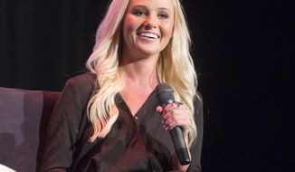 FILE - In this Aug. 29, 2017, file photo, conservative commentator Tomi Lahren attends Politicon in Pasadena, Calif. Fox News Channel has hired Lahren, who has hosted shows on The Blaze and One America News Network along with working for a political action committee supporting President Donald Trump. Lahren received a backlash after posting a picture of a U.S. flag-themed Halloween costume on Oct. 29, 2017.  (Photo by Colin Young-Wolff/Invision/AP, File)
