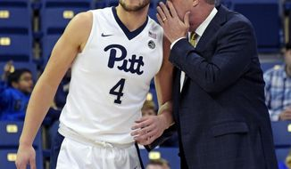 FILE - In this Nov. 14, 2016, file photo, Pittsburgh head coach Kevin Stallings, right, talks to forward Ryan Luther (4), during the first half of an NCAA college basketball game against Gardner-Webb, in Pittsburgh. Pittsburgh enters its second season under Stallings with a completely retooled roster, with Luther being one of only two scholarship team members returning from last season. The other being Jonathan Milligan. The new-look Panthers have been picked to finish last in the ACC. (AP Photo/Fred Vuich, FILE)