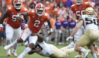 FILE - In this Saturday, Oct. 7, 2017 file photo, Clemson quarterback Kelly Bryant (2) evades a tackle from Wake Forest defensive lineman Zeek Rodney (93) during the first half of an NCAA college football game in Clemson, S.C. Georgia, Alabama, Notre Dame and Clemson are the top four teams in the first College Football Playoff rankings of the season, Tuesday, Oct. 31, 2017. (AP Photo/Rainier Ehrhardt, File)