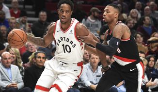 Toronto Raptors guard DeMar DeRozan drives to the basket on Portland Trail Blazers guard Damian Lillard during the first quarter of an NBA basketball game in Portland, Ore., Monday, Oct. 30, 2017. (AP Photo/Steve Dykes)