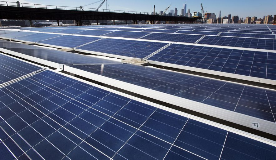 In this Feb. 14, 2017, file photo, a rooftop is covered with solar panels at the Brooklyn Navy Yard, Tuesday, Feb. 14, 2017, in New York. A U.S. trade commission is recommending that the Trump administration impose tariffs of up to 35 percent to slow an influx of low-cost solar panels imported from China and other countries. (AP Photo/Mark Lennihan, File)