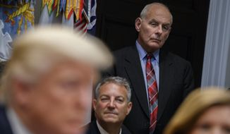 White House chief of staff John Kelly listens as President Donald Trump speaks during a meeting on tax policy with business leaders in the Roosevelt Room of the White House, Tuesday, Oct. 31, 2017, in Washington. (AP Photo/Evan Vucci)