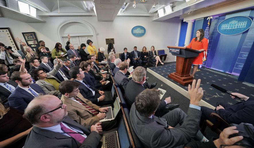 """""""You guys seem completely obsessed with this,"""" said White House press secretary Sarah Huckabee Sanders to the press on Wednesday. (Associated Press)"""