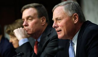 Senate intelligence committee leaders Richard Burr (right) of North Carolina and Mark R. Warner of Virginia led the questioning of tech giants Facebook, Twitter and Google on Wednesday on Capitol Hill. (Associated Press)