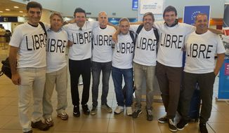From left: Hernan Ferruchi, Alejandro Pagnucco, Ariel Erlij, Ivan Brajckovic, Juan Pablo Trevisan, Hernan Mendoza, Diego Angelini and Ariel Benvenuto, gathered for a group photo Saturday before their trip to New York City from the airport in Rosario, Argentina. Mr. Mendoza, Mr. Angelini, Mr. Pagnucco, Mr. Erlij and Mr. Ferruchi were killed in the bike path attack near the World Trade Center. They were part of a group of friends celebrating the 30th anniversary of their high school graduation. (Associated Press)