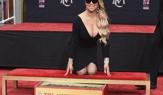 Mariah Carey poses for photographers during her hand and footprint ceremony at the TCL Chinese Theatre on Wednesday, Nov. 1, 2017, in Los Angeles. (Photo by Jordan Strauss/Invision/AP)