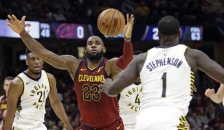 Cleveland Cavaliers' LeBron James (23) loses control of the ball against Indiana Pacers' Lance Stephenson (1) in the first half of an NBA basketball game, Wednesday, Nov. 1, 2017, in Cleveland. (AP Photo/Tony Dejak)