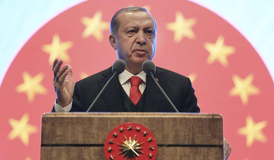 Turkey's President Recep Tayyip Erdogan gestures as he delivers a speech at a tourism council in Ankara, Turkey, Wednesday, Nov. 1, 2017. (Pool Photo via AP)