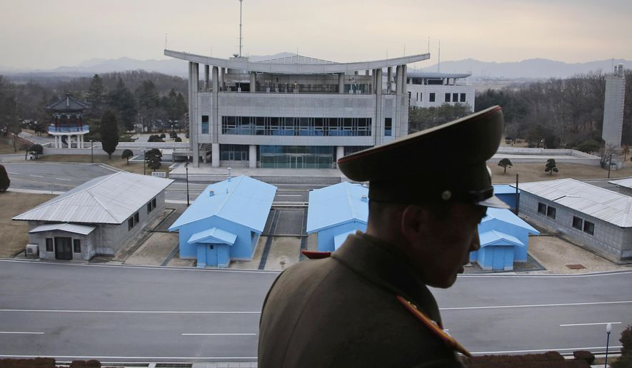 A North Korean army officer looks out at the Demilitarized Zone (DMZ) which separates the two Koreas, in Panmunjom, North Korea. (AP Photo/Wong Maye-E, File)