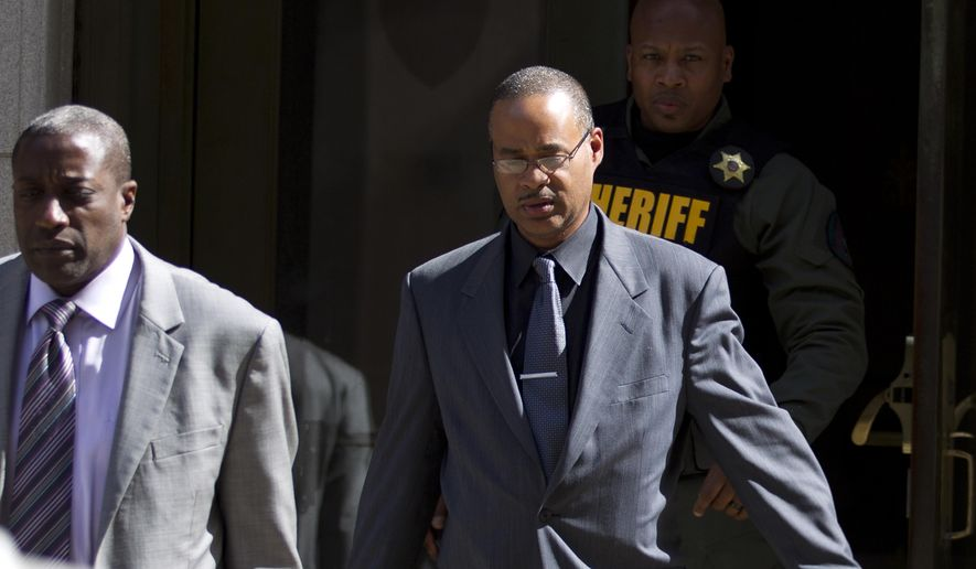 In this June 10, 2016, file photo, Officer Caesar Goodson, center, leaves the courthouse after his trial in the death of Freddie Gray in Baltimore. (AP Photo/Jose Luis Magana, File)