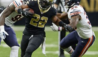 New Orleans Saints running back Mark Ingram (22) carries against Chicago Bears strong safety Adrian Amos (38) in the first half of an NFL football game in New Orleans, Sunday, Oct. 29, 2017. The Saints won 20-12. (AP Photo/Bill Feig)