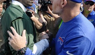FILE - In this Sept. 10, 2017, file photo, New York Jets head coach Todd Bowles, left, and Buffalo Bills head coach Sean McDermott shake hands after an NFL football game, in Orchard Park, N.Y. The Bills have been one of the NFL's biggest surprises of the season's first half despite what looked like an all-out rebuild in another potentially dismal year. McDermott's resilient squad has a chance to turn many more of the skeptics into believers on a prime-time stage against the slumping AFC East-rival New York Jets on Thursday night, Nov. 2. (AP Photo/Adrian Kraus, File)