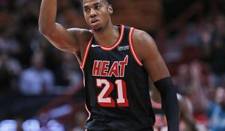 Miami Heat center Hassan Whiteside (21) celebrates a three-point shot during the first half of an NBA basketball game against the Chicago Bulls, Wednesday, Nov. 1, 2017, in Miami. (AP Photo/Wilfredo Lee)