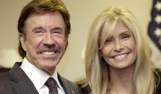 Chuck Norris, left, and his wife Gena pose for a photo following a ceremony in Garland, Texas, Dec. 2, 2010. (AP Photo/Tony Gutierrez) ** FILE **