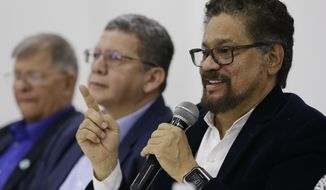 Ivan Marquez, a former leader of the Revolutionary Armed Forces of Colombia, FARC, announces that their one-time top commander, Rodrigo Londono, will run for president in next year's election during a press conference in Bogota, Colombia, Wednesday, Nov. 1, 2017. Marquez also announced the names of other nine former rebel leaders who, with him, will fill 10 seats in Congress guaranteed to the FARC political party on a temporary basis as part of last year's peace deal. (AP Photo/Ricardo Mazalan)