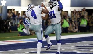 FILE - In this Oct. 8, 2017, file photo, Dallas Cowboys quarterback Dak Prescott (4) and running back Ezekiel Elliott (21) celebrate a touchdown scored by Prescott in the second half of an NFL football game against the Green Bay Packers, in Arlington, Texas. Prescott and the Cowboys are as close as they've been to playing without suspended star Ezekiel Elliott, who faces long legal odds on a third reprieve that would make him available to face Kansas City on Sunday. (AP Photo/Michael Ainsworth, File)