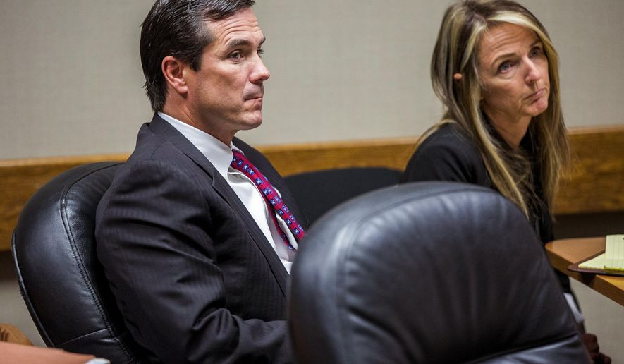Michigan Department of Health and Human Services Director Nick Lyon, left, appears in court with Britt Cobb, one of his attorneys, for his ongoing preliminary examination on Wednesday, Nov. 1, 2017, in Genesee County District Court in downtown Flint, Mich. Lyon faces charges of involuntary manslaughter and misconduct in office for his response to the Flint water crisis.  (Terray Sylvester/The Flint Journal-MLive.com via AP)