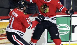 Chicago Blackhawks center Artem Anisimov, right, celebrates with defenseman Cody Franson after scoring his goal against the Philadelphia Flyers during the second period of an NHL hockey game Wednesday, Nov. 1, 2017, in Chicago. (AP Photo/Nam Y. Huh)