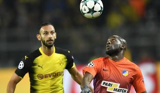 Dortmund's Omer Toprak, rear, and APOEL Nicosia's Mickael Pote in action during the Champions League group H soccer match between Borussia Dortmund and APOEL Nicosia in Dortmund, Germany, Wednesday, Nov. 1, 2017. (AP Photo/Martin Meissner)