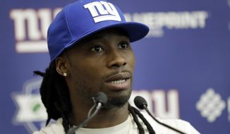 FILE - In this May 25, 2017, file photo, New York Giants cornerback Janoris Jenkins speaks to reporters during the team's organized team activities at its NFL football training facility, in East Rutherford, N.J. Jenkins has been suspended indefinitely for a violation of team rules. The suspension takes effect immediately, meaning Jenkins will miss Sunday's home game against the Rams. Jenkins was told Tuesday, Oct. 31, 2017, he was suspended.  (AP Photo/Julio Cortez)
