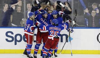 Mika Zibanejad, center, celebrates with teammates Mats Zuccarello (36), Kevin Shattenkirk (22) and Pavel Buchnevich (89) after scoring a goal during the third period of an NHL hockey game against the Vegas Golden Knights Tuesday, Oct. 31, 2017, in New York. The Rangers won 6-4. (AP Photo/Frank Franklin II)