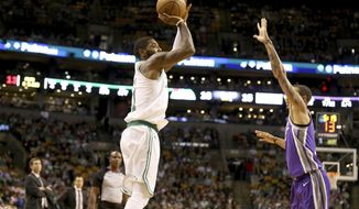 Boston Celtics' Kyrie Irving (11) shoots over Sacramento Kings' George Hill (3) during the first half of an NBA basketball game in Boston, Wednesday, Nov. 1, 2017. (AP Photo/Mary Schwalm)