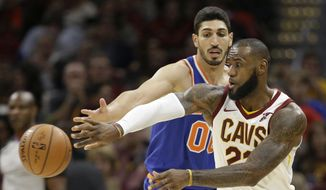 Cleveland Cavaliers' LeBron James (23) passes against New York Knicks' Enes Kanter (00) in the second half of an NBA basketball game, Sunday, Oct. 29, 2017, in Cleveland. The Knicks won 114-95. (AP Photo/Tony Dejak)