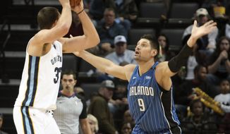 Orlando Magic Nikola Vucevic (9) guards Memphis Grizzlies Marc Gasol (33) in the first half of an NBA basketball game Wednesday, Nov. 1, 2017, in Memphis, Tenn. (AP Photo/Karen Pulfer Focht)