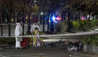 Bicycles and debris lay on a bike path at the crime scene where investigators work after a motorist earlier in the day drove onto the path near the World Trade Center memorial, striking and killing several people Tuesday, Oct. 31, 2017. (AP Photo/Craig Ruttle)