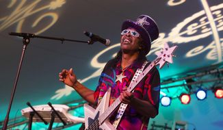 In this Friday, Oct. 26, 2012, file photo, Bootsy Collins performs at the Voodoo Experience in New Orleans. (Photo by Barry Brecheisen/Invision/AP, File)