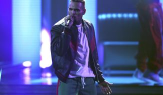 "FILE - In this Sunday, June 25, 2017, file photo, Chris Brown performs at the BET Awards at the Microsoft Theater in Los Angeles. Brown released a 45-song album ""Heartbreak on a Full Moon"" on Tuesday, Oct. 31. (Photo by Matt Sayles/Invision/AP, File)"