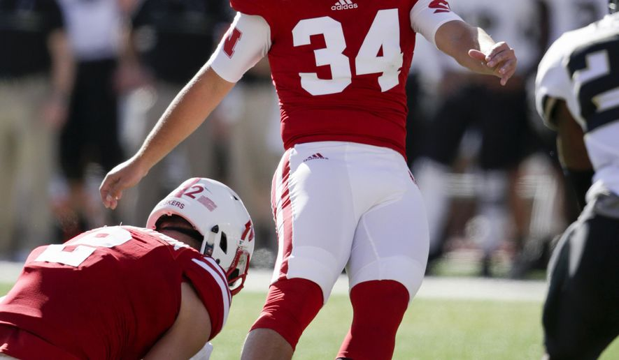 FILE - In this Oct. 22, 2016 file photo, Nebraska kicker Drew Brown (34) kicks a field goal during the first half of an NCAA college football game against Purdue in Lincoln, Neb. Back in 1998, 3-year-old Drew Brown would kick a miniature football outside the Nebraska locker room as he and his family waited for big brother and future NFL kicker Kris Brown after games. This week Drew could pass his brother Kris on the school's all-time field-goal chart. (AP Photo/Nati Harnik, File)