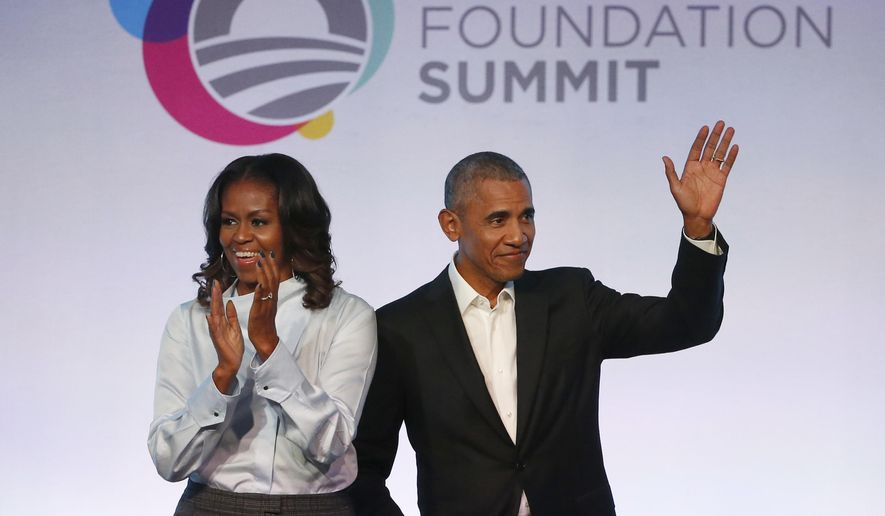 Former President Barack Obama, right, and former first lady Michelle Obama arrive for the first session of the Obama Foundation Summit Tuesday, Oct. 31, 2017, in Chicago. (AP Photo/Charles Rex Arbogast)