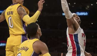 Detroit Pistons forward Tobias Harris, right, wins a rebound over Los Angeles Lakers forward Kyle Kuzma, top left, and guard Jordan Clarkson during the first half of an NBA basketball game Tuesday, Oct. 31, 2017, in Los Angeles. (AP Photo/Kyusung Gong)