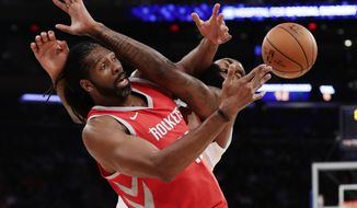 Houston Rockets' Nene Hilario, left, fights for control of the ball with New York Knicks' Kyle O'Quinn during the first half of an NBA basketball game Wednesday, Nov. 1, 2017, in New York. (AP Photo/Frank Franklin II)