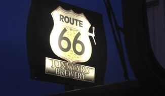 "In this Dec. 10, 2015 photo provided by Henry Lackey a sign of the Route 66 Junkyard Brewery is seen in Grants, N.M. The brewery is facing a U.S. federal lawsuit from the Cyprus-based Lodestar Anstalt over claims the hangout is illegally using the iconic American highway in its name. According to the lawsuit filed in U.S. District Court in Albuquerque, Lodestar owns the U.S. trademark for Route 66 beers in the country and the highway's ""shield"" that go on labels for beer. (Henry Lackey via AP)"