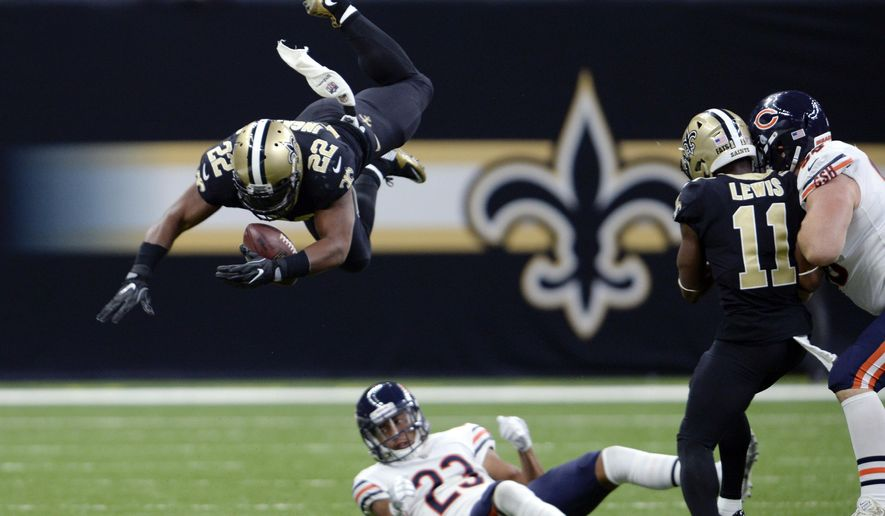FILE - In this Sunday, Oct. 29, 2017, file photo, New Orleans Saints running back Mark Ingram (22) regains control of the ball as he leaps over Chicago Bears cornerback Kyle Fuller (23) in the first half of an NFL football game in New Orleans. While Mark Ingram has played a central role in the Saints' five-game winning streak, coach Sean Payton was clearly concerned by his late-game fumbles last weekend. As New Orleans prepares to host Tampa Bay, Ingram is trying to regain the trust of teammates and coaches.(AP Photo/Bill Feig, File)